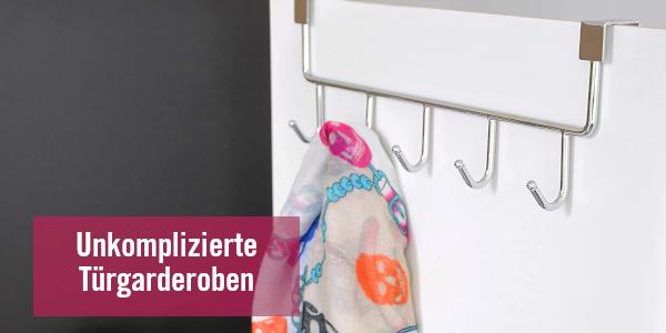 Kleiderhaken – Türgarderobe an weißer Tür auf der ein Tuch hängt